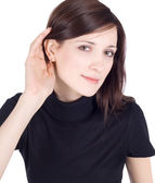 Young brunette listening gossip — Stock Photo