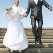 Husband and bride jumping — Stockfoto