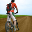 Stock Photo: Mountain bike race on ground road
