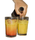 Barmen making tequila sunrise — Stock Photo