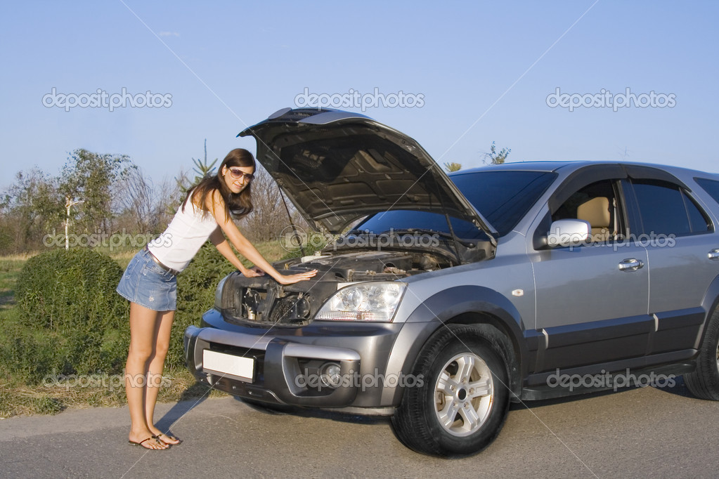 Beautiful brunette girl repairing the car  Stock Photo #2870623