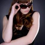Fashion portrait of sexy young beautiful woman wearing sunglasse — Stock Photo