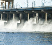 Reset of water at hidroelectric power station on the river — Stock Photo