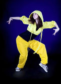 Teenage girl dancing hip-hop in the darkness — Stock Photo