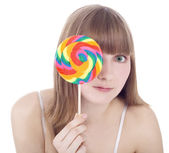 Happy blonde with color lollipop — Stock Photo