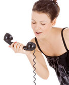 Young alluring girl calling at the phone — Stock Photo