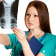 Female doctor looking at xray picture — Stock Photo