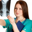 Stock Photo: Female doctor looking at xray picture