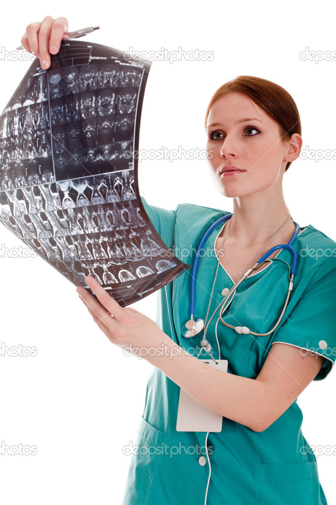 Female doctor looking at xray picture  Stock Photo #2880685