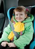 Cute little girl in a car — Stock Photo