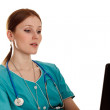 Young medical nurse with the laptop — Stock Photo