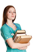 Portrait of female doctor with books — Stock Photo