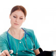 Female doctor in the green uniform — Stock Photo