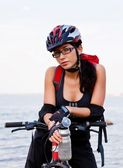 Pretty girl and bicycle — Stock Photo
