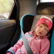 Little girl sleeping in a car - Stock Photo