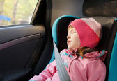 Little girl sleeping in a car — Stock Photo