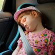 Cute little girl sleeping in a car - Stock Photo