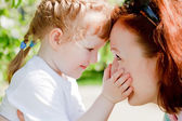 Young mother and her cute little daughter — Stock Photo