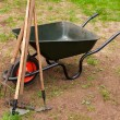 Wheelbarrow in a garden — Stok fotoğraf