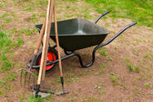 Wheelbarrow in a garden — Foto Stock