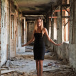 Woman in the abandoned building — Stock Photo