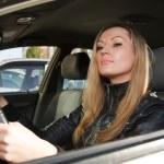 Pretty woman in a car — Stock Photo