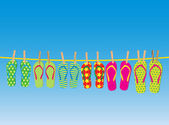 Flip-flops on a rope — Stock Vector