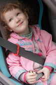 Cute little girl in a baby car seat — Foto de Stock