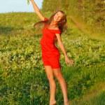 Jumping pretty brunette girl — Stock Photo