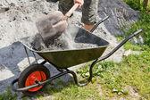 Somebody filling the wheelbarrow — Stock Photo