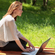 Pretty young woman with a laptop at park — Stock Photo #3399869