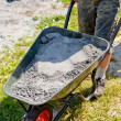 Stock Photo: Somebody pushing wheelbarrow