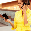 A pretty business woman talking on the phone — Stock Photo