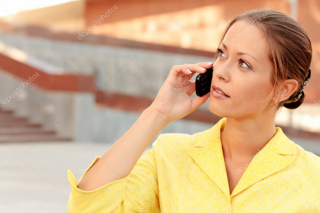 Beautiful business woman on the phone at modern building  — Stock Photo #3442892
