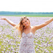 Portrait of a beautiful woman on a green meadow — Stock Photo