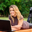 Young pretty woman with laptop — Stock Photo #3493803