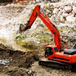 Stock Photo: Excavator standing in sandpit with risen bucket