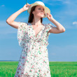 Stock Photo: Young beautiful woman on field in summer