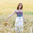 Pretty girl in a field - Stock Photo