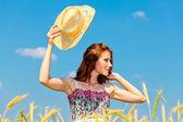 Pretty girl in a field — Stock Photo