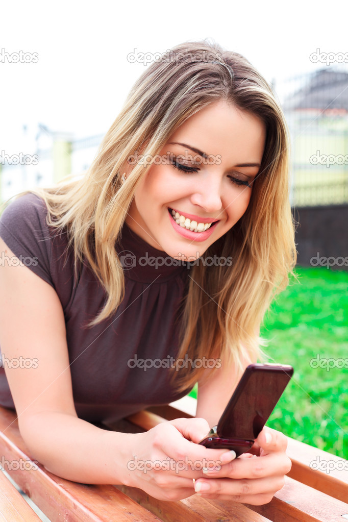 Young woman reads sms — Stock Photo #3572219