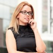 Beautiful young businesswoman talking by mobile phone — Stock Photo