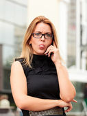 Businesswoman showing her tongue — Stock Photo