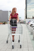 Woman with Shopping Cart — Stock Photo