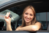 Woman Showing The Key Of Her New Car — Stock Photo