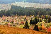 Beautiful autumn mountain and the village — Stock Photo