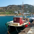 Red fishing boat in port of Mykonos — Stock Photo #2810936