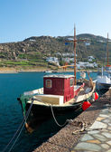 Red fishing boat in port of Mykonos — Stock Photo