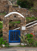 Blue gate with stone arch, staircase — Stock Photo