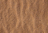 Yellow undulating sea sand — Stock Photo